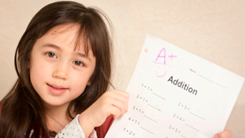 Grades Girl holding up test px350.png